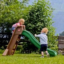 glijbaan kindvriendelijk vakantieadresje met kleine kinderen Jonge Gezinnenweek zomervakantie in de bergen Berghut Rauris Oostenrijk